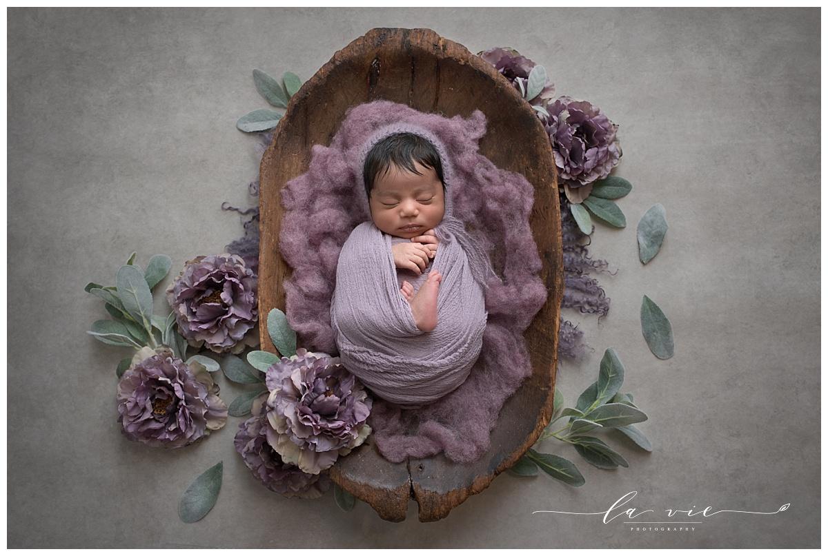 Fine art newborn portrait with organic florals and wood by Houston Newborn Photographer La Vie Photography