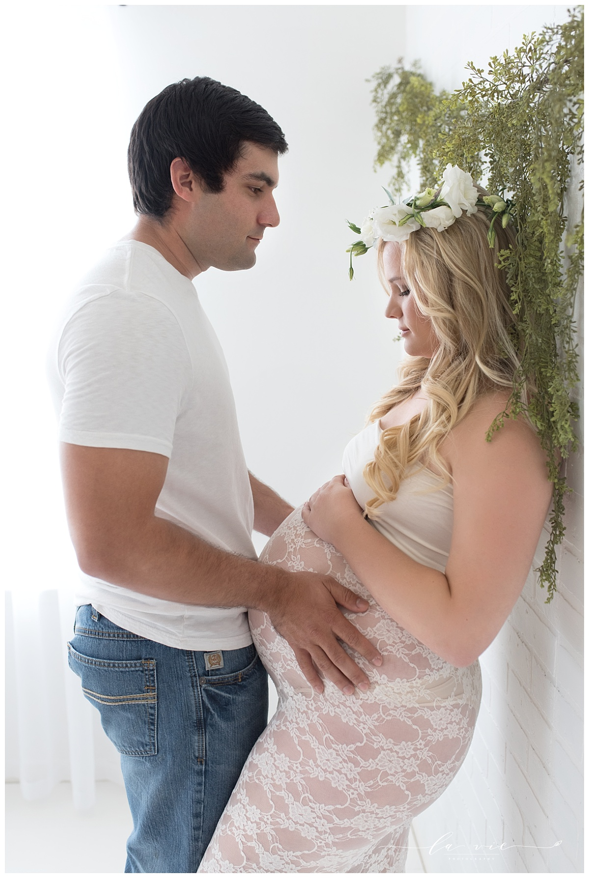 couples maternity portrait all white set with greenery