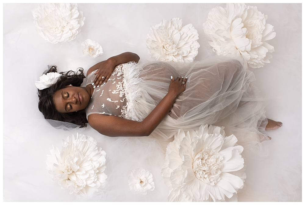 Maternity portrait all white gown with white flowers